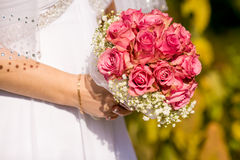 Luxury white dress and bridal bouquet Royalty Free Stock Image