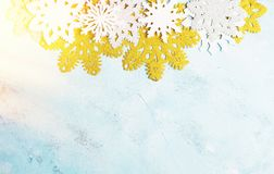 Luxury white and golden snowflakes on light blue background. Winter, Christmas, New year concept stock photography