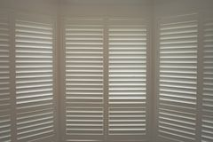 Free Luxury White Indoor Plantation Shutters, Closed Shutters Stock Image - 111073361