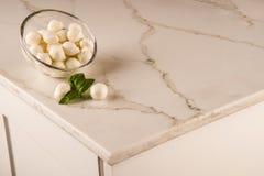 Luxury white kitchen marble countertop. Marble counter concept. White carrara counter. Luxury kitchen with brown marble countertop and mozzarella on it. kitchen stock images
