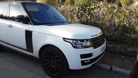 Luxury White Land Rover Range Rover SUV. Roquebrune-Cap-Martin, France - January 25, 2019: Luxury White Land Rover Range Rover SUV Parked In The Street. French stock video footage