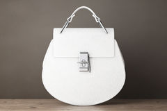 Luxury White Leather Women Bags. 3d Rendering. Luxury White Leather Women Bags on a wooden table. 3d Rendering Royalty Free Stock Photography