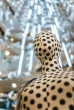 Luxury white mannequin with black dot in fashion mall shopping d Stock Image