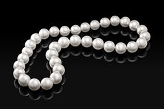 Luxury white pearl necklace on a black background with glossy reflection Stock Photography