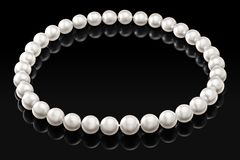 Luxury white pearl necklace on a black background with glossy reflection Royalty Free Stock Photos