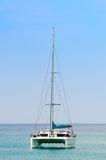 Luxury white sail catamaran boat in the sea Stock Photos