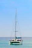 Luxury white sail catamaran boat in the sea Stock Photos