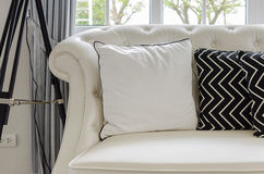 Luxury white sofa in living room with white pillows Royalty Free Stock Images