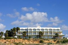 Luxury white Spanish hotel on the beach Royalty Free Stock Image
