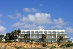 Luxury white Spanish hotel on the beach royalty free stock image