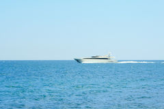 Luxury white speed yatch in open waters Stock Photo