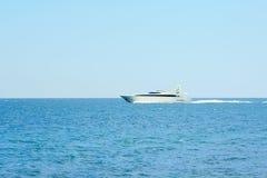 Luxury white speed yatch in open waters Stock Photo