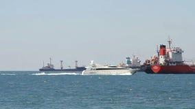 Luxury white speed yatch in open waters stock video