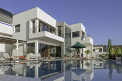 Luxury white villa with swimming pool Stock Images