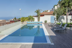 Luxury white villa with swimming pool. And sea view stock photo