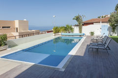 Luxury white villa with swimming pool. And sea view royalty free stock photo