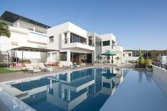 Luxury white villa with swimming pool stock photos