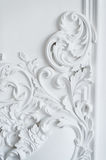 Luxury white wall design bas-relief with stucco mouldings roccoco element Royalty Free Stock Images