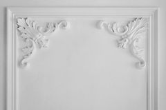 Luxury white wall design bas-relief with stucco mouldings roccoco element Royalty Free Stock Photography