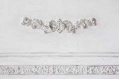Luxury white wall design bas-relief with stucco mouldings roccoco element. Elements of torsel ornament for use as a Royalty Free Stock Photography