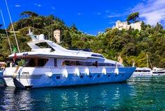 Luxury white yacht in harbour of Portofino, Italy stock image