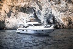 Luxury white yacht. 10 July 2016 unrecognized persons on luxury white yacht navigates into beautiful blue water near Zakynthos. Greece Stock Photography