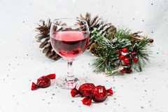 Luxury wine and chocolates in a snowy white Christmas scene. Royalty Free Stock Photos