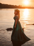Luxury witch in a long green dress  for lake Royalty Free Stock Photo
