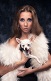 Luxury woman. Beautiful woman in luxury fur coat with russian toy-terrier Royalty Free Stock Photo