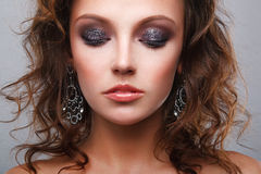 Luxury woman. Close-up of a young, beautiful, brown-haired woman Stock Images