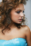Luxury woman. Close-up of a young, beautiful, brown-haired woman Stock Photography