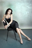 Luxury woman. Beautiful woman sitting on the chair Stock Photography