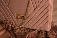 Luxury woman bag on scarves. With animal print Royalty Free Stock Images