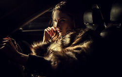Luxury woman in a car. Royalty Free Stock Photo