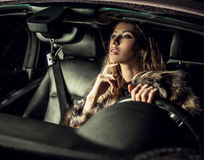 Luxury woman in a car. Stock Photography