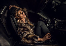 Luxury woman in a car. Stock Image