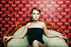 Luxury  woman in the chair Stock Photography