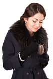 Luxury woman in a coat looks into an empty wallet. Luxury woman in a black coat looks into an empty wallet Stock Image