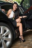 Celebrity. Luxury woman coming out of the car Stock Photo
