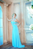 Luxury woman in fashionable dress in rich interior Royalty Free Stock Photo