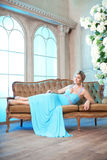 Luxury woman in fashionable dress in rich interior Royalty Free Stock Photos