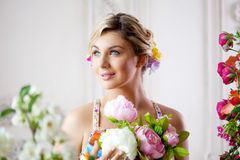 Luxury woman in fashionable dress in rich interior Stock Photography