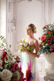 Luxury woman in fashionable dress in rich interior Stock Photos