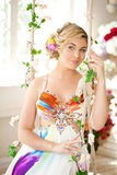 Luxury woman in fashionable dress in rich interior Royalty Free Stock Images