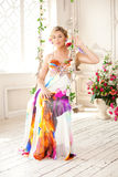 Luxury woman in fashionable dress in rich interior Stock Images