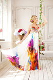 Luxury woman in fashionable dress in rich interior Royalty Free Stock Image