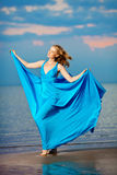 Luxury Woman In A Long Blue Evening Dress On The Beach. Beauty Royalty Free Stock Images