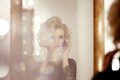 Luxury woman with and mirror Royalty Free Stock Images