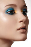 Luxury woman model face with bright fashion make-up, clean skin Stock Images