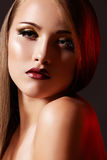 Luxury woman model with fashion retro lips make-up. Chic evening style. Glamour portrait of alluring woman model. She's wearing luxury fashion make-up, dark red stock photography